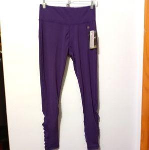 Bally shape enhancing dry-wik purple leggings M